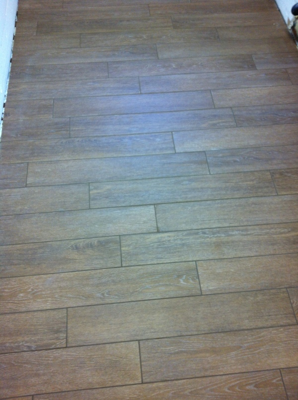 How much wood, would a wood tile tile?
